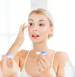 woman applying beaty product on her face